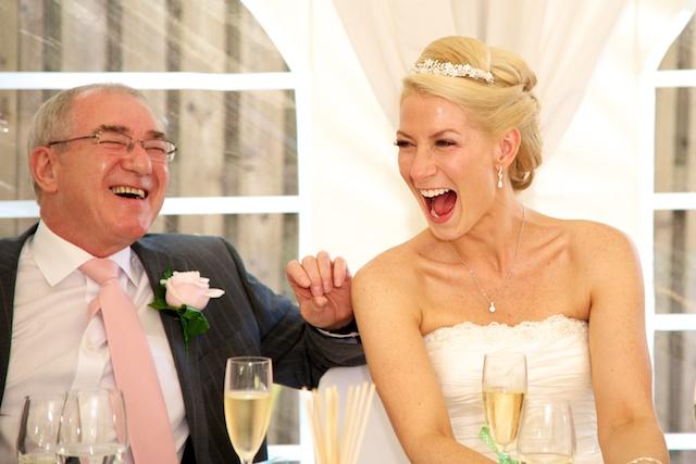Sarah laughs at wedding reception