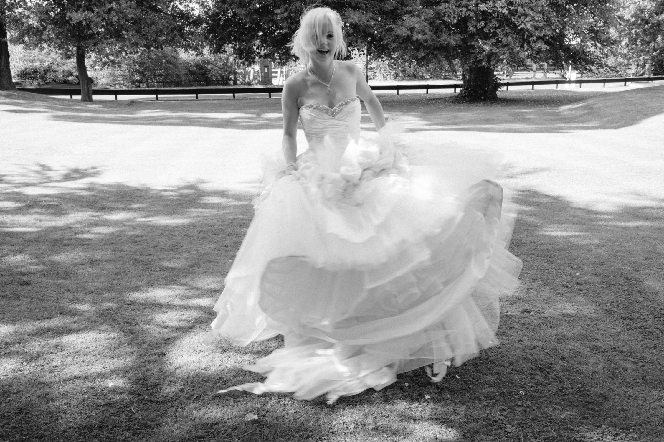 bride spinning in her wedding dress at Carys Manor