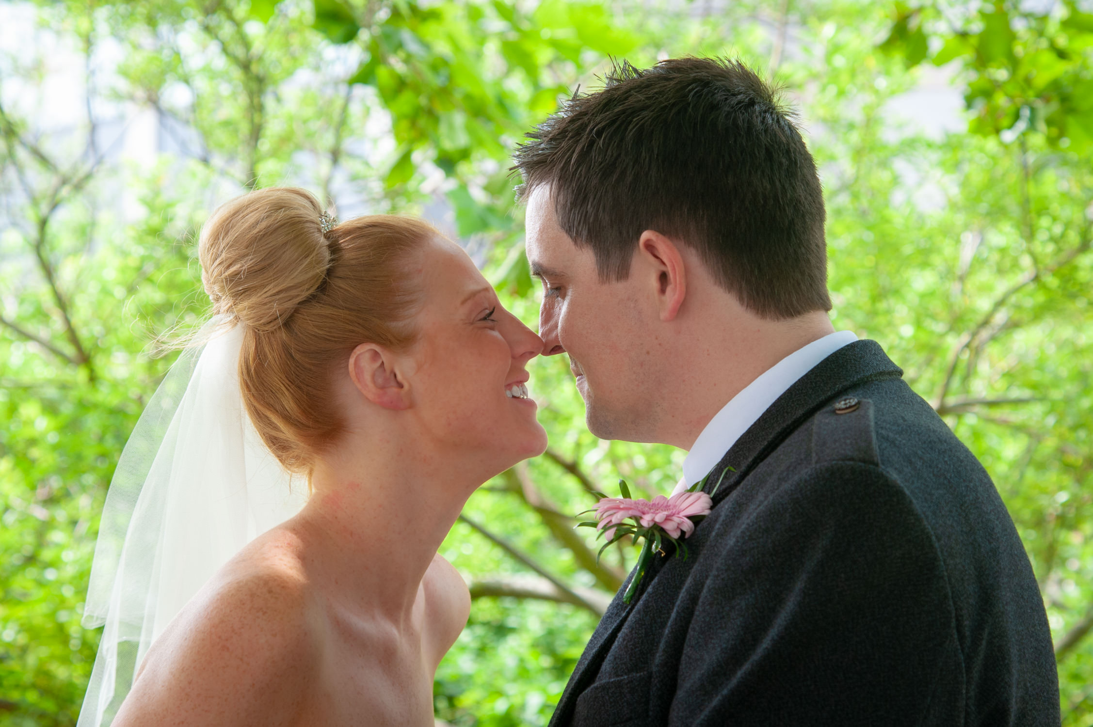 bride and groom having a kiss